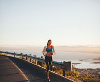 Young woman her morning run Royalty Free Stock Photo
