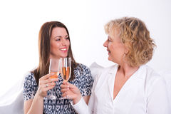 Young woman and her mother drinking champagne Royalty Free Stock Photos