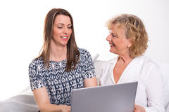 Young woman and her mother with laptop Royalty Free Stock Photography