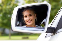 Young woman in her new car Royalty Free Stock Image