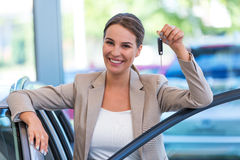 Young woman with her new car Royalty Free Stock Image