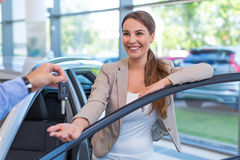 Young woman with her new car Stock Photography