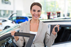 Young woman with her new car Stock Images