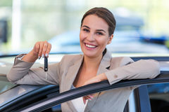 Young woman with her new car Royalty Free Stock Photography