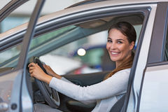 Young woman with her new car Stock Image