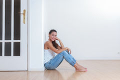 Young woman in her new home stock photography