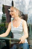 Young woman in her function as a bus driver Royalty Free Stock Photo