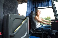 Young woman in her function as a bus driver. Young woman in her occupation as a couch driver Stock Image