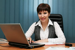Young woman in her office Royalty Free Stock Images