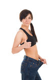 Young woman in her old jeans after losing weight Royalty Free Stock Images