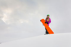 Young woman and her orange snowboard Stock Photos