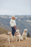 Young woman and her pet dogs Royalty Free Stock Images