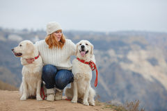 Young woman and her pet dogs Royalty Free Stock Photography