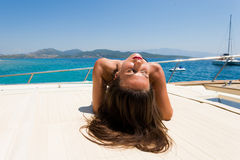 Young woman on her private yacht Stock Image