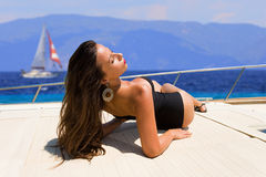 Young woman on her private yacht. Young sexy woman on her private yacht Royalty Free Stock Photo
