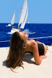 Young woman on her private yacht Stock Photos