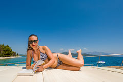 Young woman on her private yacht Stock Photography