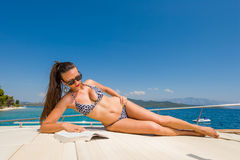 Young woman on her private yacht Royalty Free Stock Photography