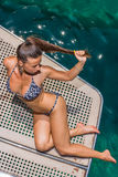 Young woman on her private yacht Royalty Free Stock Image