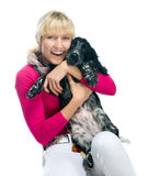 Young woman with her puppy Stock Images