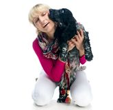 Young woman with her puppy Royalty Free Stock Photos