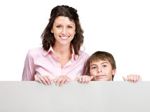 Young woman and her son holding a blank board Stock Photo
