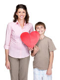Young woman and her son holding a heart Stock Photos