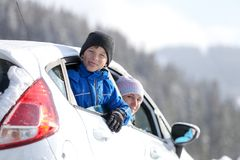 Young woman with her son on winter vacation. Winter family traveling concept image. Young women with her son on winter vacation royalty free stock images