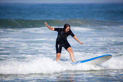 Young woman on her surfboard Royalty Free Stock Photography