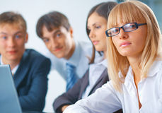 Young woman with her team Stock Photography