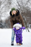 Young woman with her toddler girl at the winter park Royalty Free Stock Images
