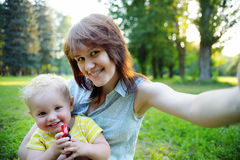 Young woman and her toddler son making selfie Stock Photo