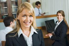 Young woman with her work team Stock Photos
