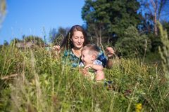 Young woman with her young son having fun outdoors Stock Photo