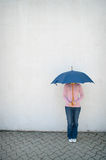 Young woman hidden under umbrella Royalty Free Stock Photography