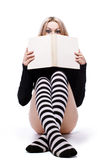Young woman hide about book Stock Images