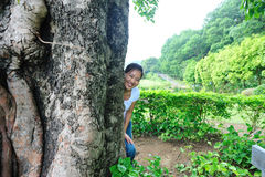 Young woman smile behind lime tree Stock Photos