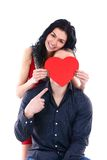 young woman hides her face behind a guy Stock Photography