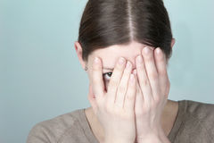 Young woman hiding Stock Image