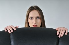 Young woman hiding behind big Royalty Free Stock Images