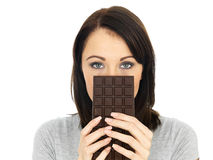 Young Woman Hiding Behind a Chocolate Bar Stock Image