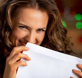 Young woman hiding behind envelope Royalty Free Stock Image