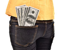 Young woman hiding dollars in pocket money Royalty Free Stock Images