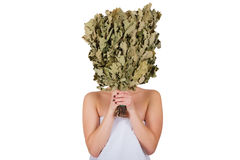 Young woman hiding face with oak broom Royalty Free Stock Photos