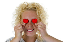 Young woman hiding her eyes with texture hearts Stock Photo