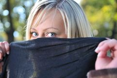 Young woman hiding her face Stock Image