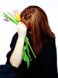 A young woman is hiding her face away Stock Photos