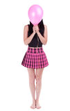 Young woman hiding her face behind pink balloon royalty free stock images