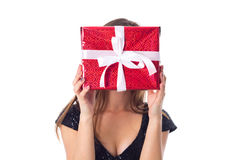 Young woman hiding her face by the present Royalty Free Stock Photography