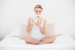 Young woman hiding her mouth with a cuddly toy Royalty Free Stock Images